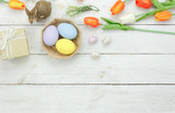 Table top view shot of decoration Happy Easter holiday background concept.Flat lay bunny egg with tulip flower and rabbit doll on modern white wooden at office desk.Blank space blackboard for mock up. - 194057350