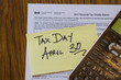 Tax Form with Sticky note with Deadline close up