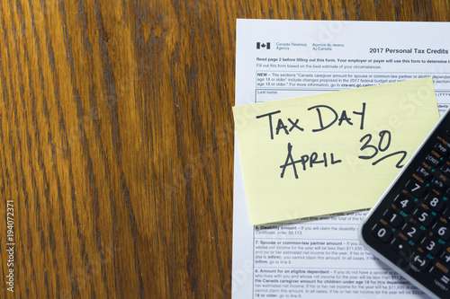 Fotobehang Canada Tax Form with Sticky note with Deadline close up