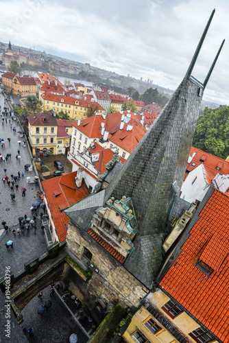 Tuinposter Praag Prague, Czech Republic - October 10, 2017: Top view on tourists, ancient roofs and the Charles Bridge, Prague, Czech Republic