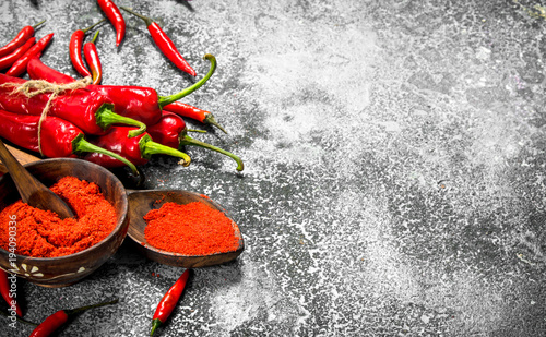 Tuinposter Hot chili peppers Ground red hot chili peppers in a bowl.