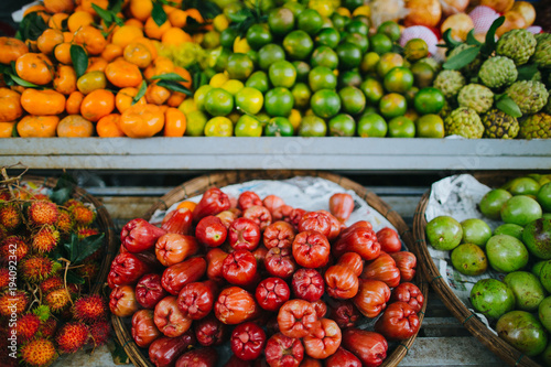 close-up view of exotic fruits in baskets on shelves, Hoi An, Vietnam