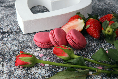 Sweet and colourful french macaroons or macaron with strawberry Poster