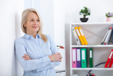 Portrait of beautiful middle aged businesswoman in office
