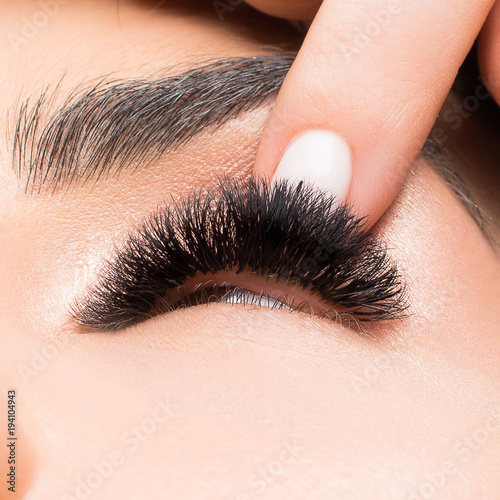 Closeup image of beautiful woman eye with fashion makeup and long eyelashes - 194104943