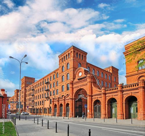 Fototapeta Genuine industrial architecture, with unplastered red brick buildings