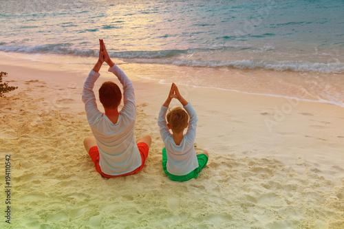 Aluminium School de yoga father and son doing yoga at sunset beach