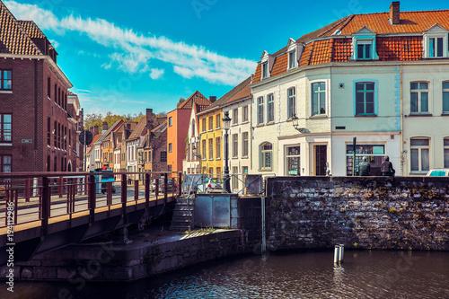 Deurstickers Brugge Medieval town Bruges. Old house at vintage street. Bridge over