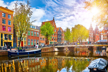 Channel in Amsterdam Netherlands houses river Amstel landmark