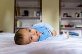 Eurasian baby on bed - 194114350
