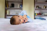 Eurasian baby on bed - 194114570