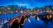 Bridge Blue hour arch over canal in Amsterdam Netherlands. - 194116547