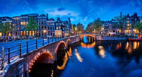 Tuinposter Natuur Bridge Blue hour arch over canal in Amsterdam Netherlands.