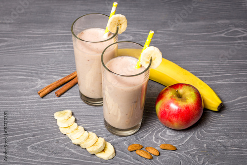 Foto op Plexiglas Milkshake Banana and apple milk smoothie with almonds and cinnamon