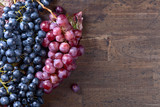 Grapes bunch with leaves on a old wooden background. - 194127711