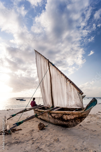 Fotobehang Zanzibar Dhow on the beach in Zanzibar. Fishing boat on the beach.