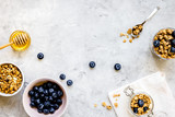 Oat flakes with honey and berries on table background top view - 194137370