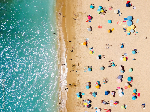 Aerial View From Flying Drone Of People Crowd Relaxing On Beach In Portugal © radub85