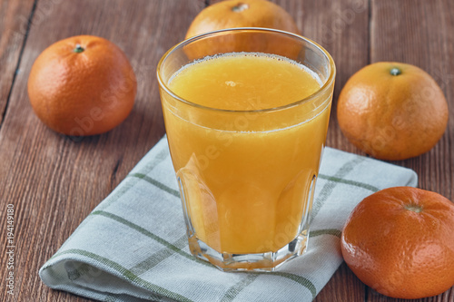 Foto op Canvas Sap Fresh organic orange juice in a glass beaker. Healthy eating.