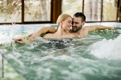 Fototapeta Loving couple relaxing in hot tub