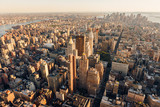 Aerial view at sunset of Manhattan below 30th Street (along 5th Avenue) including Midtown, Flatiron District, Chelsea, East Village, Lower Manhattan and the Financial District - 194164998