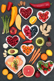 Food to maintain a healthy heart concept with salmon, vegetables, fruit, spice, nuts on slate background. Super foods high in antioxidants, vitamins, minerals, omega 3 fatty acids and anthocyanins.  - 194167194