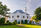 The blue church in Bratislava. Saint Elizabeth church view from the side trough the park. - 194185509