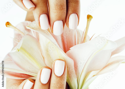 beauty delicate hands with manicure holding flower lily close up - 194206778