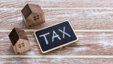 Tax sign and house model - 194222975