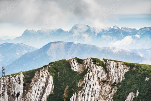 Plexiglas Herfst Mountains in foggy morning. Austrian Alps.