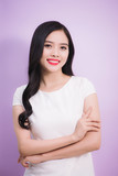 Portrait of a friendly young asian woman laughing with long black hair - 194226505