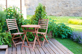 empty wood table and chairs on the terrace at summer day - 194232768