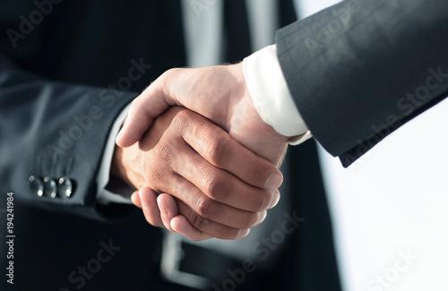 Staande foto Wanddecoratie met eigen foto Business men giving a handshake. Business concept