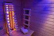 Leinwanddruck Bild Private infrared sauna in ultra violet light