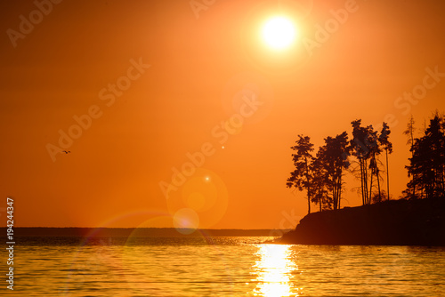 Deurstickers Oranje eclat Beautiful sunset on a sea coast with lens flare