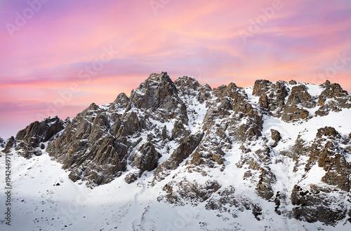 Deurstickers Lichtroze Pink sunrise in snowy mountains