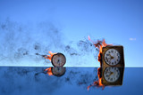 Two antique clock burning in space on mirror, time concept
