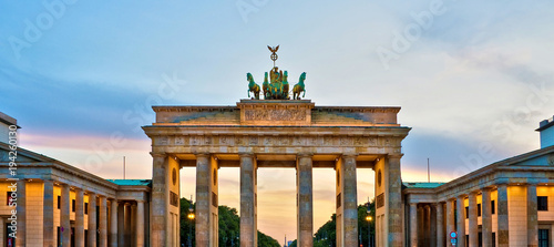 Brandenburg gate illuminated at sunset , Berlin, Germany © Delphotostock