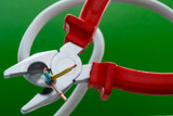 pliers and electric wire on a greem background/ pliers and electric wire on a green background - 194263532
