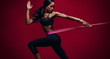 Strong woman using a resistance band in her exercise routine