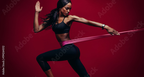 Aluminium Fitness Strong woman using a resistance band in her exercise routine