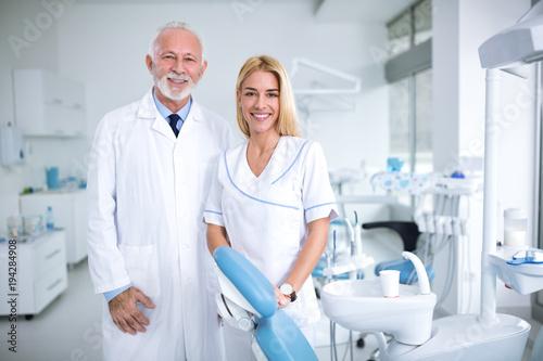 Fototapeta Two smiling dentists in a dental office