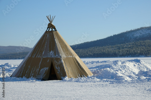 Blue sky Winter polar landscape with eskimo tent.