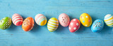 Row of colorfully painted Easter eggs - 194294501