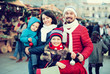 Happy parents with children with Christmas decoration