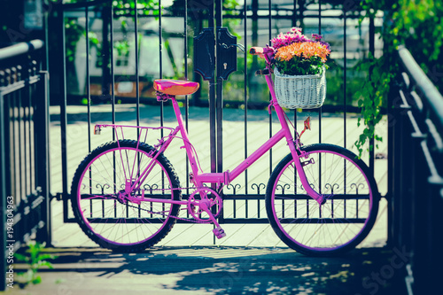 Plexiglas Fiets pink bike standing by metal barrier