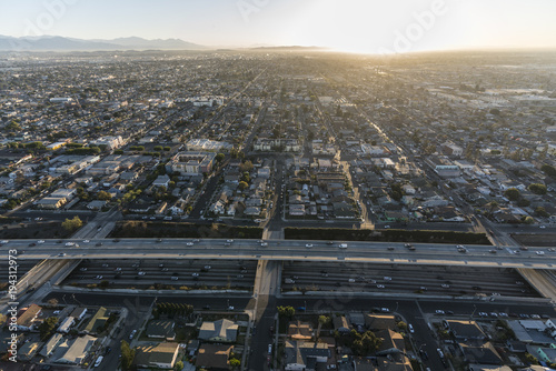 Early morning aerial view of the double decked Harbor 110 Freeway at 52nd Street south of downtown Los Angeles in Southern California.