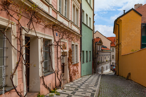 Fotobehang Smalle straatjes Calm street in old town, no people. Charming Prague, Czech Repubic.