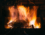 Burning firewood and branches for coal, long exposure photo of fire