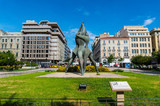 Klathmonos square is the center the Historical Center of Athens. In the square is an impressionistic monumental bronze sculptural group of three intertwined figure - 194334356